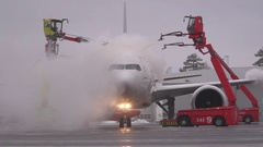 Huge airplane deice heavy smoke wet environment cold ice Stock Footage
