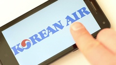 The world's largest airlines. Logos on smartphone screen Stock Footage