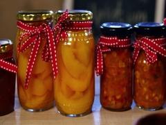 Jars of pestos, jam and preserves on display counter Stock Footage