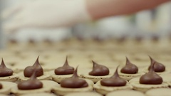 Making macarons, adding chocolate filling, close-up view Stock Footage