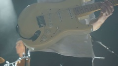 Close-up: man playing an electronic guitar on a concert Stock Footage