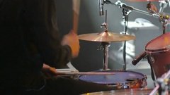 Close-up - the drummer playing on a drum set on a concert Stock Footage