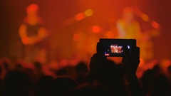 The fan shooting a video on a smartphone from a rock concert Stock Footage