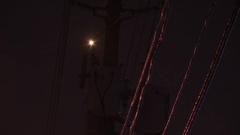 Electrical fire at power transformer in ice storm Stock Footage