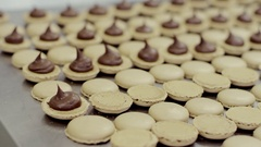 Some of yellow macarons' halves coated with cream Stock Footage
