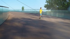 Child on a pennyboard, flares, slow motion Stock Footage