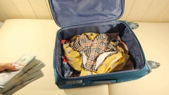 Young Woman Puts Tickets In The Suitcase And Closes The Zipper. 2 Shots Stock Footage