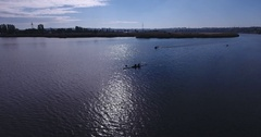 Aerial view Two rowing and motor boat on calm water of  great river Stock Footage