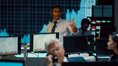 4K Manager in busy stock exchange overseeing staff & keeping them motivated Stock Footage