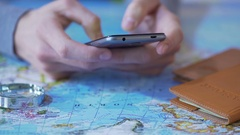 Person using smartphone for vacation planning, booking flight and hotel room Stock Footage
