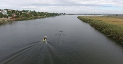 Aerial view training athletes canoeists on river boat on trainer Stock Footage