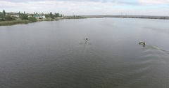 Aerial view training athletes canoeists on river with views of city Stock Footage