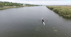 Aerial view canoe with two paddlers sails on smooth river 4k Stock Footage