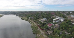 Aerial view of river with smooth water on shore of small house on hill Stock Footage