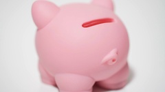 Person putting penny coin in piggy bank, raising money on private account Stock Footage