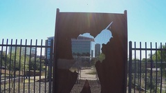 Tilt Soldier Silhouette Shadow Through Memorial Wall Tempe AZ Stock Footage