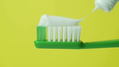 Tooth brush with tooth paste close up Stock Footage