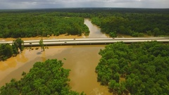 Aerial drone dolly over flooded Amite River in Baton Rouge Stock Footage