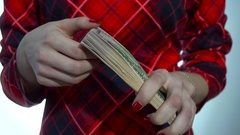 Woman in red dress counts a pack of money in hands in slow motion Stock Footage