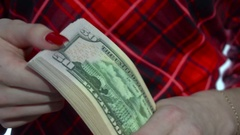Girl in red dress counts a pack of money in hands in slow motion Stock Footage