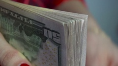 Close up of young business woman with pack of money in hands Stock Footage