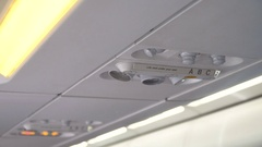 Airplane interior, signs on an airplane Stock Footage
