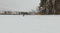 Racing on a snowmobile Stock Footage