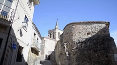 Medieval church next to old defensive wall in Zamora. Tilt motion Stock Footage