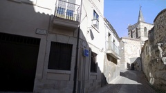 Medieval church next defensive wall in the historic center of Zamora. Pan motion Stock Footage