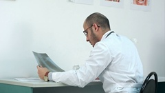 Young male doctor examining chest xray image Stock Footage