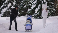 Winter in the forest. Family spend their free time. As long as the child Stock Footage