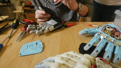 Man builds innovative product - robotic arm printed with 3d Printer Stock Footage