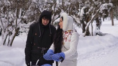 A walk in the woods. Winter. Young couple with a child walking in the woods. A Arkistovideo