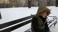 Young boy freezing in the ice cold winter snow Stock Footage