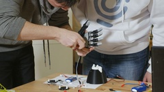 Electronic bionic prosthetic arm. Engineers work at lab making robotic bionic Stock Footage