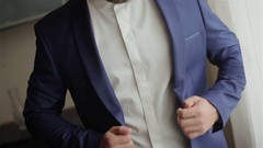 Stylish well-dressed man in blue suit buttons jacket no face close-up Stock Footage