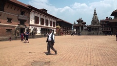 Local people on background of historic buildings architecture of Kathmandu. Stock Footage