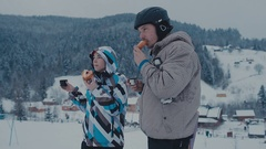 Tea break during skiing on the mountain. Man and woman drinking tea at a ski Stock Footage