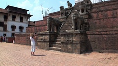 Girl photographs the elements of architecture in Kathmandu Nepal Durbar Square Stock Footage