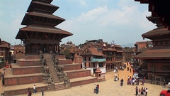 Tourists and locals on square near temple. Architecture of buildings Kathmandu. Stock Footage