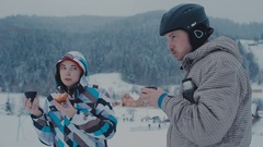 Tea break during skiing on the mountain. Man and woman drinking tea at a ski Stock Footage