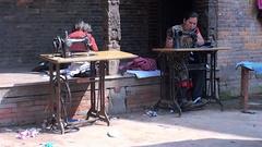Women sew things on the street of Kathmandu in Nepal. Stock Footage