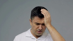 Unhappy man suffering from head ache Stock Footage