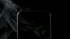 SLOW MOTION: Smoke from smartphone on a black background - Close up Stock Footage