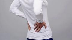 Woman suffering from backache Stock Footage