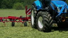 Tractor is making a turn and hay is flying around Stock Footage