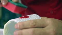 Master Hand making sponge pattern on a ceramic mug. Professional designer. Stock Footage