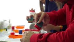 Hand of master making sponge pattern on a ceramic mug. Slow motion. Stock Footage