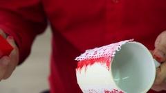 Hand of designe rmaking pattern on a ceramic mug. Creative Workshop. Stock Footage