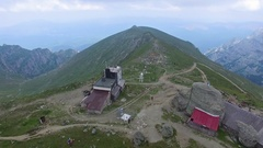 Aerial view of the Omu peak and chalet, Bucegi mountains, Romania Stock Footage